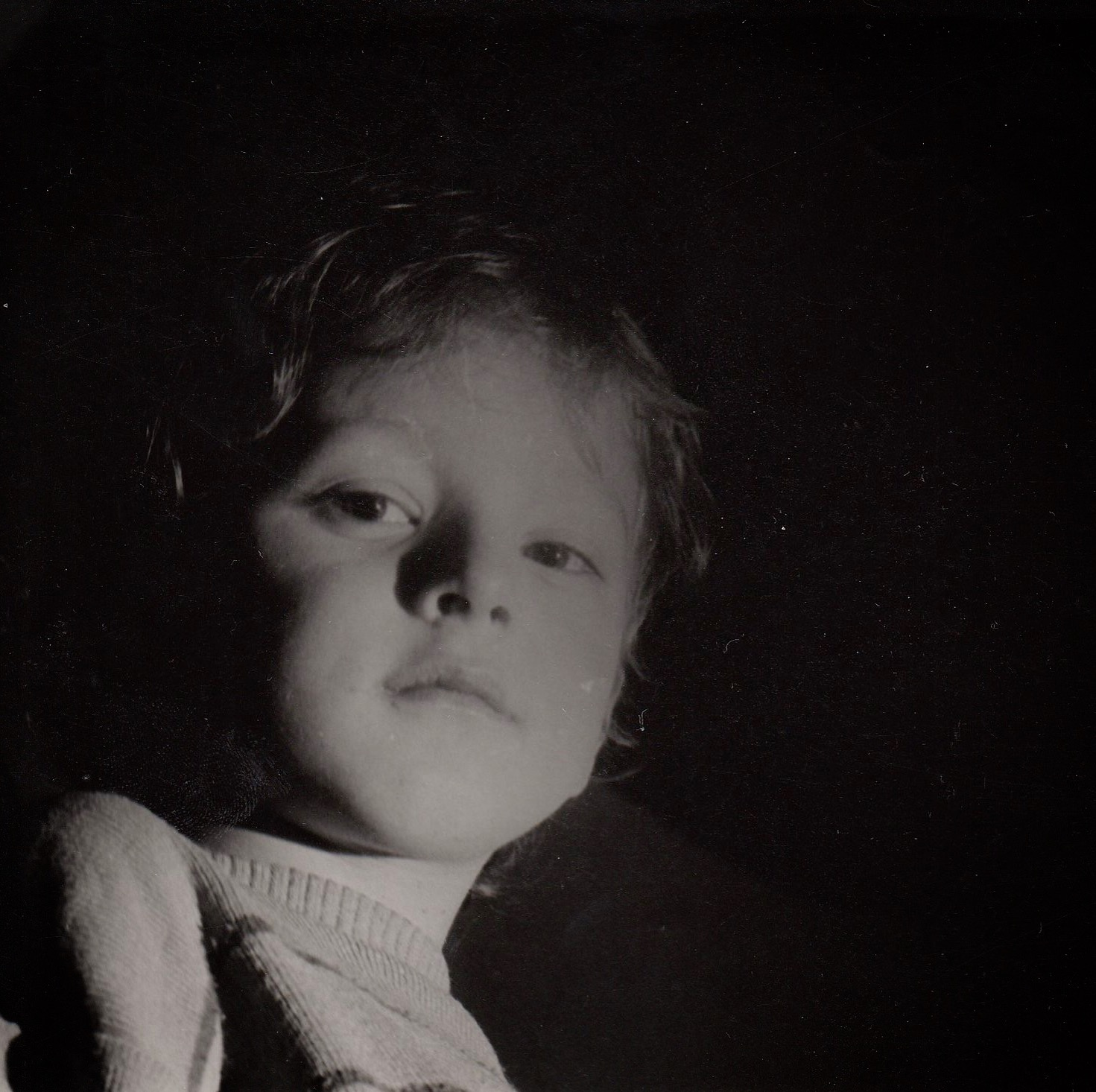 Black and white portrait of a 4 year old child with curly hair